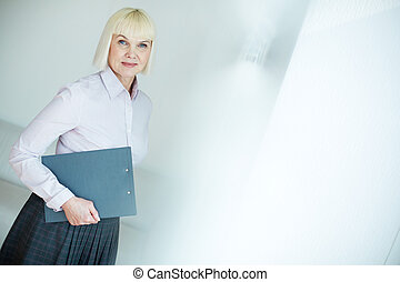 Woman with document - Portrait of mature businesswoman with...