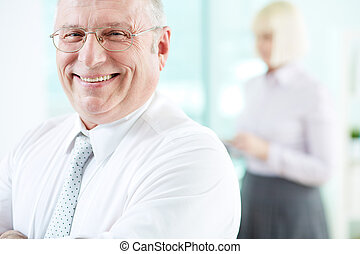 Joyful employer - Portrait of smiling boss looking at camera...