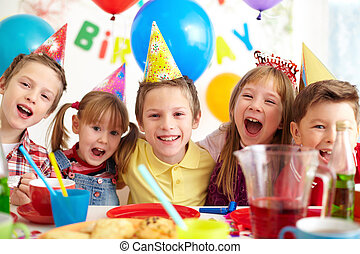 Birthday joy - Group of adorable kids looking at camera at...