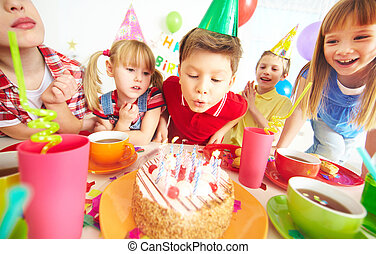Birthday wish - Group of adorable kids gathered around...