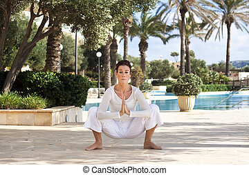 Senior lady doing yoga - Photo of a middle aged lady doing a...