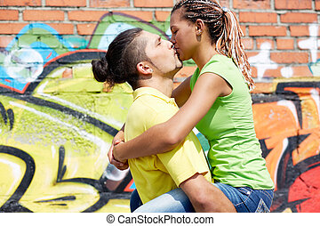 Passion - Image of young couple sharing kiss on background...
