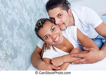 Togetherness - Image of young guy and his girlfriend looking...