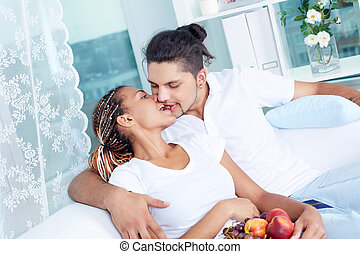 Eating together - Image of young guy and his girlfriend...