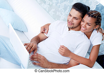 Free time - Image of young guy and his girlfriend using...