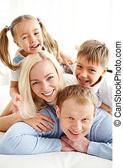 Joyful mood - Portrait of happy family laughing
