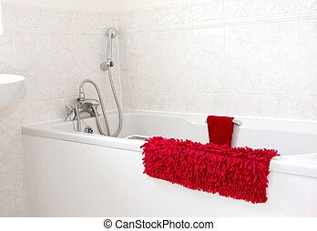 white bathroom with red towels