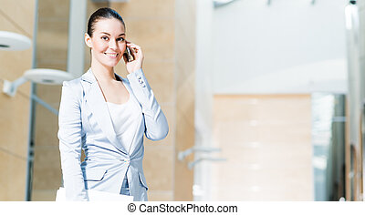 Portrait of a successful business woman in the office,...