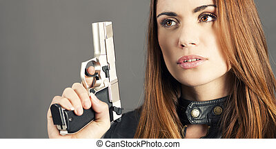 Panoramic gun - woman holding up her weapon