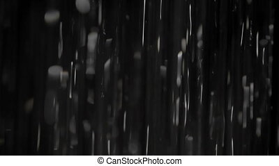 Rain on black. Can be mixed with your footage in screen...
