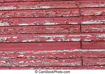 Peeling paint on red barnboard - Old weathered background of...