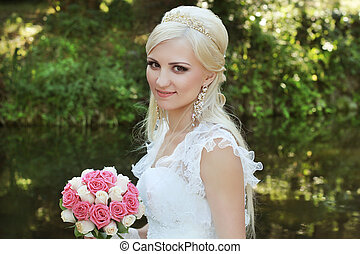 Beautiful bride with bouquet of flowers, Outdoors portrait
