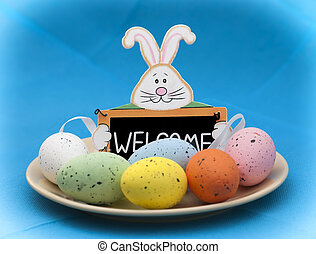 Easter bunny with a plate full of colorful eggs