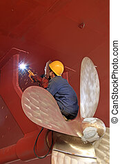 industrial workers welding ship propeller, north china