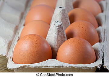 Egg carton with fresh brown eggs