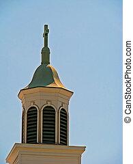 church steeple cross against light blue sky