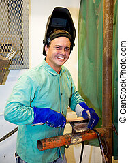 Portrait of Friendly Welder - Friendly, smiling welder...