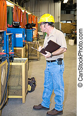Safety Check of Welding Equipment - Inspector performing a...