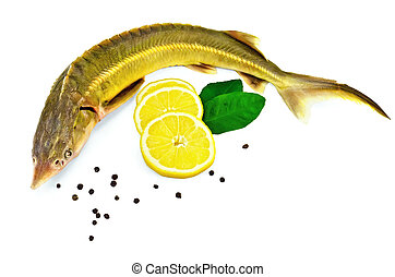 Fish starlet with lemon and leaf - Sturgeon fish with lemon,...