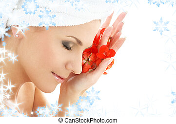 happy woman with red flower petals in spa