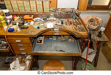 Goldsmith workbench - Workbench of a goldsmith with all...