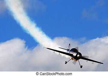 Stunt Air-plane with smoke trail blue sky and cloud...