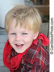 Cowboy Smile - Toddler with red bandanna and flannel shirt