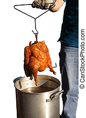 Deep Fried Turkey - Deep fried turkey with a pot of oil,...