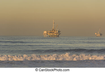 Offshore Oil Rigs taken from Huntington Beach California at...