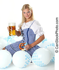 Blonde Bavarian Girl sitting in a sky of ballons, smiling
