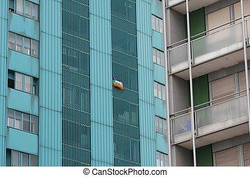 peace flag hung a huge condominium skyscraper in Italian...