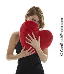 Woman with heart pillow