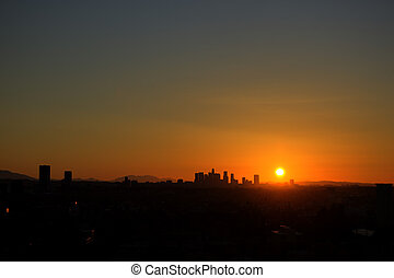Sunrise with heat haze of Downtown Los Angeles skyline