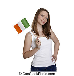 Attractive woman shows flag of Ireland and smiles in front...