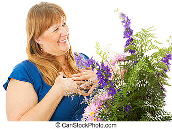 The Gift of Flowers - Pretty blond woman receiving a...