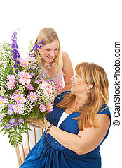 Flowers for Mother - Beautiful blond teenage girl giving...