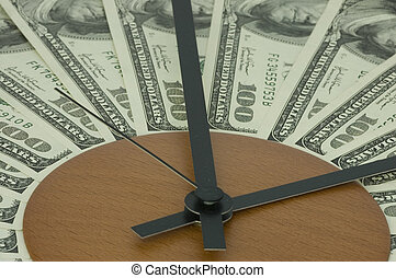 Time is money. - Banknotes lying on a dial and symbolising...