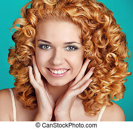 Red Wavy Hair. Healthy Curly Hair. Beautiful happy smiling...