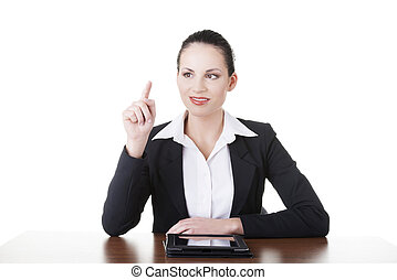 Businesswoman working on tablet computer with touch pad.