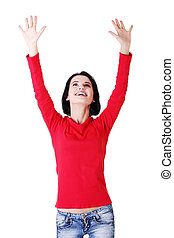 Excited happy young woman with hands up, isolated