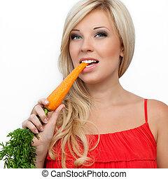 girl eating vitamin rich carrot - beautiful girl eating...