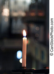 Candles in the church - candles glowing in the church