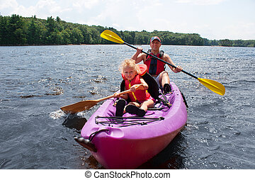 Father and daughter kayaking - Father and his 3-years old...