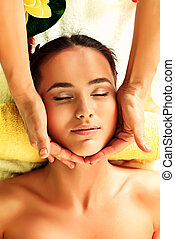 face rejuvenation - Beautiful young woman taking spa...