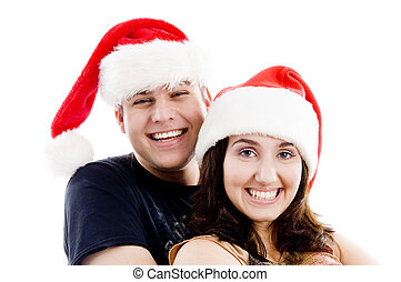 portrait of pleased couple with christmas hat on an isolated...