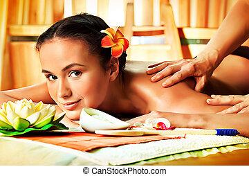 woman massage - Beautiful young woman taking spa treatments...
