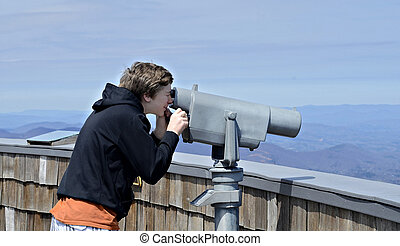 Boy Looking at View - A young boy on Brasstown Bald looking...