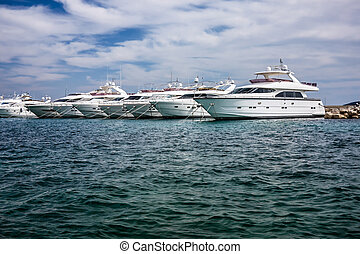 Motor yachts in the harbour - Motor yachts moored in the...