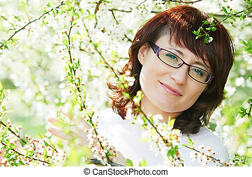 Smiling woman at spring blossom
