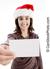 woman wearing christmas hat holding business card on an...